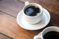 Coffee Mug on Wooden Table. Royalty Free Stock Images