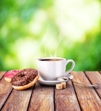 Coffee mug on a wooden table nature bokeh Stock Photos