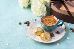 Coffee mug with yellow and chocolates royalty free stock images