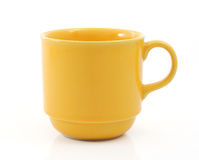 Coffee mug. Yellow coffee mug isolated on white Royalty Free Stock Photo