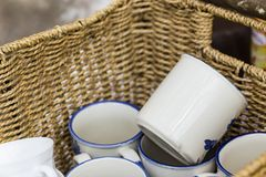 Coffee mugs in a basket Royalty Free Stock Photography