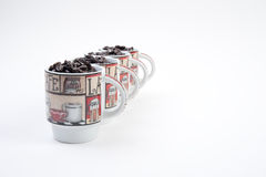 Coffee Mugs with Beans Royalty Free Stock Photos