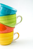 Coffee mugs. Colorful coffee mugs on white background. stacked tea cups isolated royalty free stock photography
