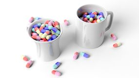 Coffee mugs full of pills. Isolated on white background Royalty Free Stock Photography