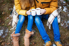 Coffee mugs iron in the hands of lovers. Stock Images