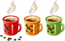 Coffee Mugs-3.jpg. Three color mugs of hot coffee Stock Photography