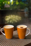 Coffee. 2 mugs of coffee on the mat Royalty Free Stock Image