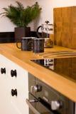 Coffee mugs in modern designer kitchen Royalty Free Stock Image