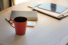 Coffee mugs and office supplies Put on the table. In the afternoon Royalty Free Stock Image