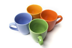 Coffee mugs set. Coffee mugs with four different colors over white stock images