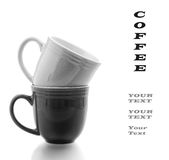 Coffee Mugs Stacked in Black and White on a white background with copyspace Stock Photo