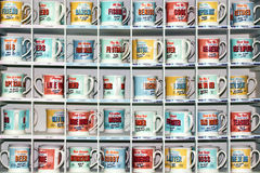Coffee mugs stacked in a row Royalty Free Stock Images