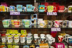 Coffee mugs store best. In industry stock image