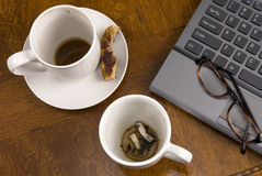 Coffee mugs and stress with laptop Stock Images