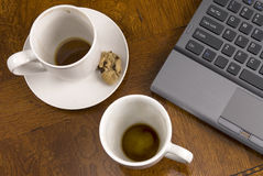 Coffee mugs and stress with laptop Stock Photos