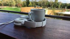 Coffee music headphones 4k stock video footage