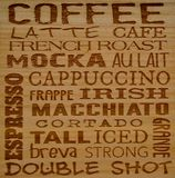 Coffee names. Block macrocarpa wood engraved with names of different coffee names or makes Royalty Free Stock Image