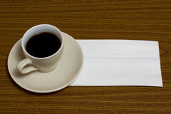 Coffee with napkin Stock Photos