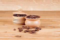 Coffee natural. Coffee in a pot on a wooden background Royalty Free Stock Photos