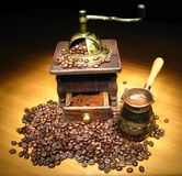 Coffee naturmort. Antiquity coffee machine with beans and fresh coffee in cezv Royalty Free Stock Photo