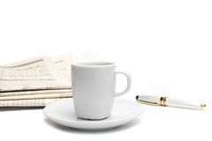 Coffee near financial newspaper and pen Stock Photos