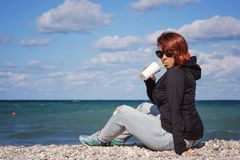 Coffee near the sea stock photos