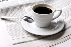 Coffee, news. Cup of coffee and the fresh newspaper of news, business Stock Image