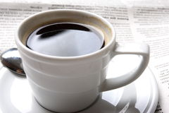 Coffee, news. Cup of coffee and the fresh newspaper of news, business Royalty Free Stock Images