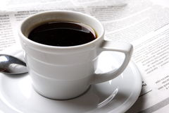 Coffee, news. Cup of coffee and the fresh newspaper of news, business Stock Photo