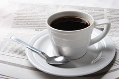 Coffee, news. Cup of coffee and the fresh newspaper of news, business Stock Photos