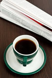 Coffee and newspaper Stock Images