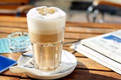 Coffee and newspaper. Morning impression with newspaper and latte machiato royalty free stock image