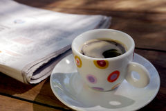 Coffee and newspaper in a cafe Royalty Free Stock Photography