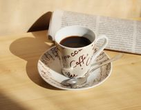 Coffee and newspaper Stock Image