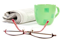 Coffee and newspaper with glasses. Stock Photos