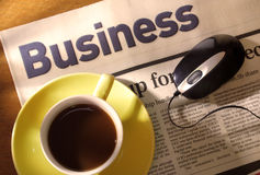 Coffee, Newspaper and Mouse on Desk Stock Photos