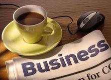 Coffee, Newspaper and Mouse on Desk Royalty Free Stock Photos