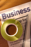Coffee, Newspaper and Notebook on Desk Stock Photos