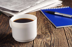 Coffee, newspaper and notepad Stock Photos