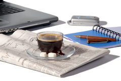 Coffee, the newspaper, pen Stock Image