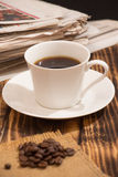 Coffee and newspaper Stock Photography