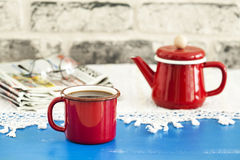 Coffee and newspaper on wooden table Royalty Free Stock Photos