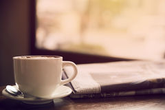 Coffee and newspapers on the table. Stock Photo