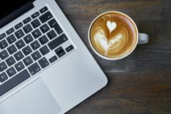 Coffee next to laptop computer