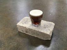 Coffee on nitro. Nitrogen coffee on brick Royalty Free Stock Photos