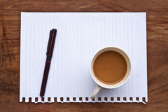 Coffee with note and pen Stock Images