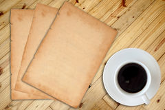 Coffee and notebook. White cup of hot coffee and white sketch book on wood table Stock Photo