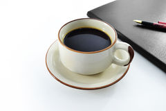 Coffee and notebook Stock Photography