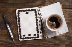 Coffee and notebook Royalty Free Stock Image