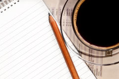 Coffee and notebook on desk. Coffee cup and notebook with pencil on desk stock images